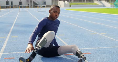 physically : Disabled athletic exercising on a running track at sports venue 4k Stock Footage