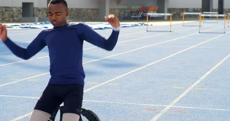 physically : Disabled athletic relaxing on a running track at sports venue 4k Stock Footage