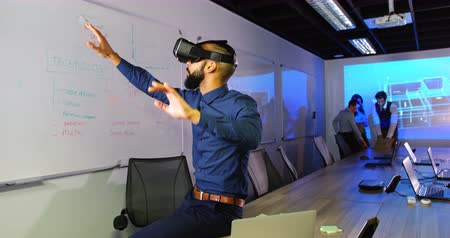 conference table : Executive using virtual reality headset in conference room at office 4k