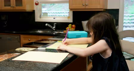 half length : Side view of little girl drawing on paper at home 4k Stock Footage