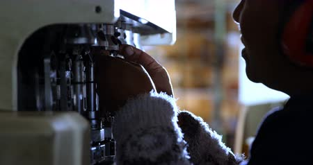 earmuffs : Close-up of worker using rope making machine 4k