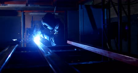 welding helmet : Attentive metalsmith using welding torch in workshop 4k