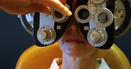 phoropter : Close-up of Optometrist examining patient eyes with messbrille 4k