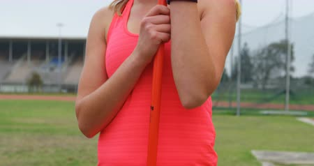javelin : Thoughtful female athlete standing with javelin stick at sports venue 4k Stock Footage