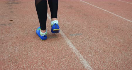 high speed track : Low section of female athlete walking on running track 4k Stock Footage