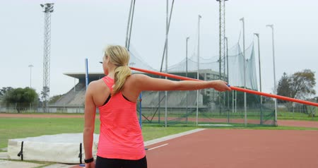 javelin : Female athlete getting ready for javelin throw at sports venue 4k Stock Footage