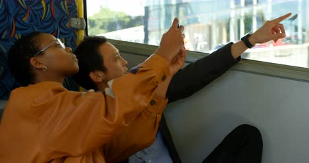 autobus de pasajeros : Young couple clicking photos with mobile phone while travelling in bus 4k Archivo de Video