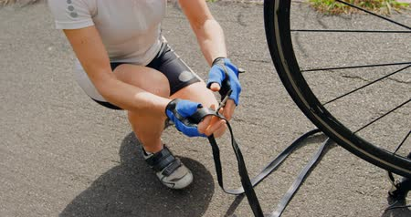 bisikletçi : Senior cyclist repairing bicycle on road at countryside 4k