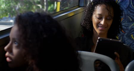 svitek : Young female commuter using digital tablet while travelling in bus 4k