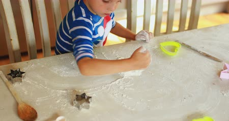 cortador : Innocent boy playing with flour at home 4k Vídeos