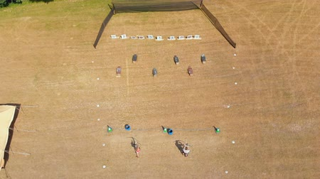 tiro com arco : Aerial view of archers practicing archery at boot camp on a sunny day 4k