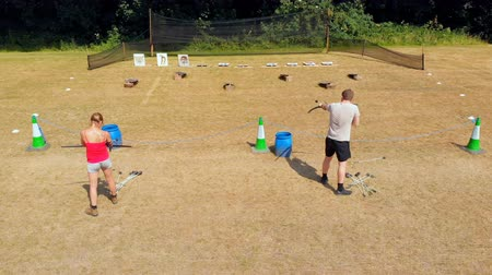 tiro com arco : Aerial of archers practicing archery at boot camp 4k