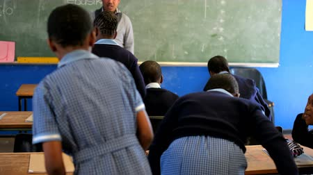schoolkid : Male teacher teaching students in the class at school 4k