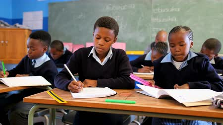 school uniform : Schoolkids studying in the classroom at school 4k Stock Footage