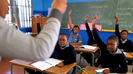 kabarık : Schoolkids hands raised in the classroom at school 4k