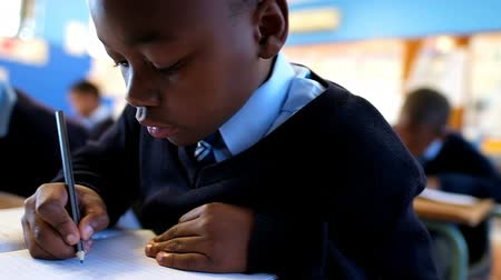 estudioso : Close-up of schoolboy studying in the classroom at school 4k