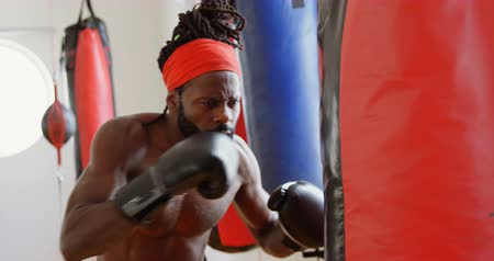 punching bag : Focused male boxer practicing boxing in fitness studio 4k