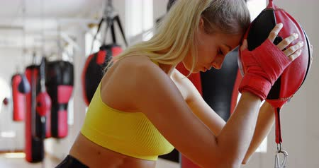 punching bag : Young female boxer exhausted while boxing in fitness studio 4k