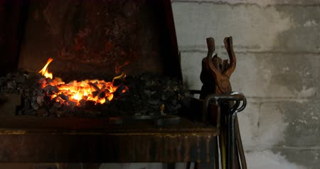 yokluk : Close up of horseshoe being heated in fire at blacksmith workshop. No people. Stok Video