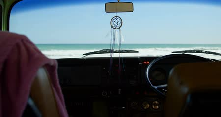 wiper : Close-up of interior of van. Sea in background 4k