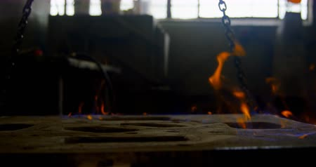 heating up metal : Close-up of mold heating in foundry workshop. Flame on mold 4k Stock Footage