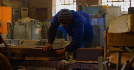 intéz : Male worker arranging molds in workshop. Molds equipment in workshop 4k