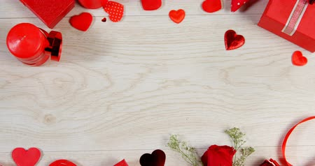 kırılganlık : Red roses, gift boxes and heart shape of confetti on wooden surface. Valentines day concept 4k