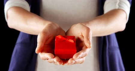luty : Close-up of hand holding small red gift box. Mid section of man holding in cupped hands 4k Wideo