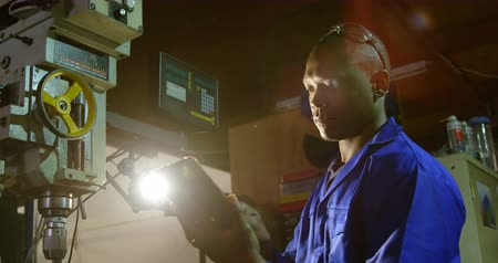 scrutiny : Male worker using digital tablet in glass factory. Male worker operating machine in glass factory 4k