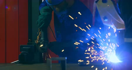 welding torch : Male robotic engineers working in robotic warehouse. Male engineer using welding torch 4k Stock Footage
