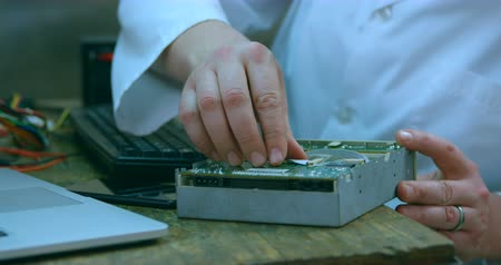 mid section : Robotic engineer assembling circuit board at desk. Close-up of circuit board 4k Stock Footage
