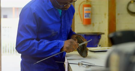 geometry compass : Worker using caliper at table in foundry workshop. Worker measuring metal casting 4k