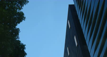 absence : Low angle view of modern office building. Beautiful and calm sky in the background 4k