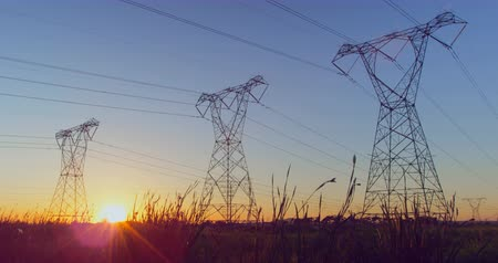 absence : Time lapsed of electricity pylon on a field during sunset. Beautiful and calm sky in the background 4k