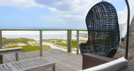 absence : Swing chair in balcony at home. Sky and sea face in background 4k Stock Footage