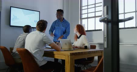 man in office : Young mixed-race business team planning and working in meeting room of modern office. They are applauding and discussing over digital screen 4k