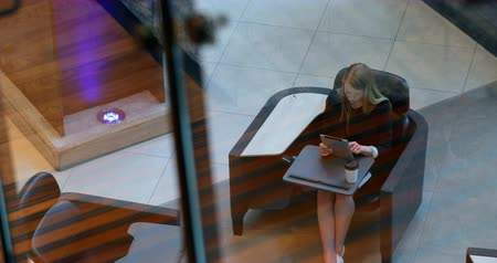 身なり : Businesswoman using digital tablet in office. Businesswoman holding digital tablet 4k