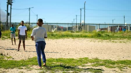 fotbalista : Player playing football in the ground. Boy passing the ball in the sports ground Dostupné videozáznamy