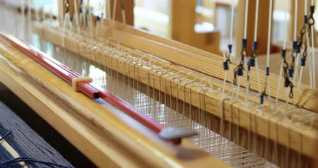 yokluk : Close-up of hand loom machine in a empty workshop. Threads on a hand loom machine 4k Stok Video