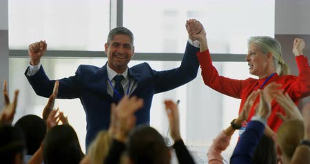 profesionales : Front view of Caucasian business people celebrating their success while being applause by the public in the business seminar 4k