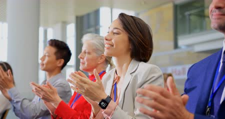 rehberlik : Side view of multi ethnic business people sitting and applauding in the business seminar 4k