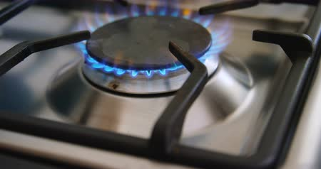 gas burner flame : Gas stove hob with fire in kitchen at home 4k