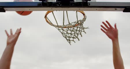 basketbal : Low angle view of Multi-ethnic basketball players playing basketball in basketball court. They are making a goal 4k