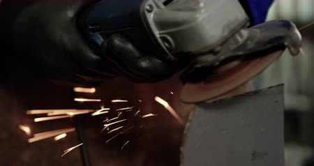 angle grinder : Close-up of Caucasian male mechanic working in repair garage. He is using angle grinder 4k Stock Footage