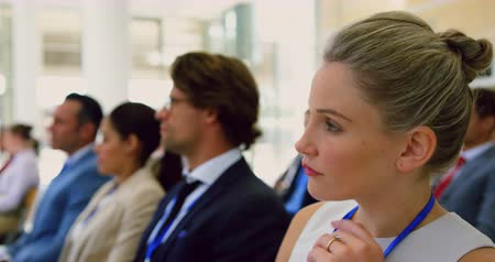 id : Side view of Caucasian Businesswoman using laptop in a seminar. She is attending a seminar 4k