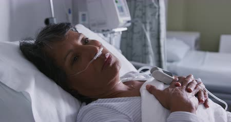 intensive care unit : Close up of senior mixed race woman wearing a nasogastric tube resting in a hospital bed 4k Stock Footage