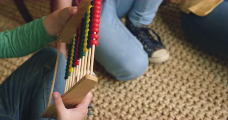 abacus : Close-up of Caucasian boy learning mathematics on abacus at home. He is playing with abacus 4k