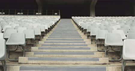 павильон : Low angle view of empty spectators seat in a stadium. Steps between spectators seat 4k