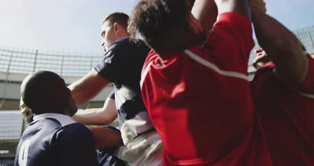 konkurenční : Low angle view of diverse rugby players playing rugby match in stadium. They are catching rugby ball 4k