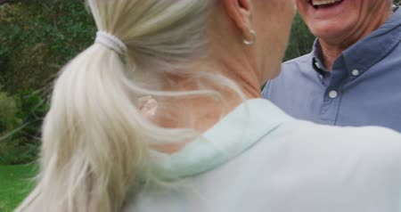 отступление : Front view close up of a happy senior Caucasian man and woman holding dancing in a garden